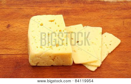 Cheese On A Wooden Background