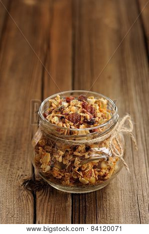 Granola In Jar With Packing-twine On Wooden Background With Space Selective Focus