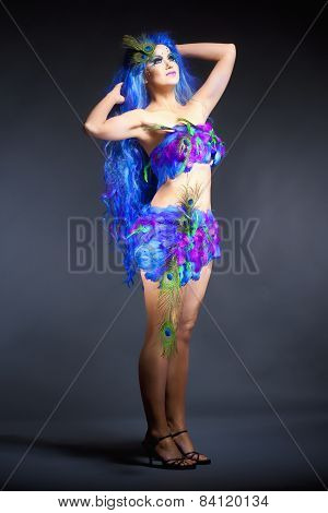 Woman In Blue Wig And Dress Of Feathers