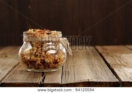 Granola In Jar With Packing-twine On Wooden Background With Space