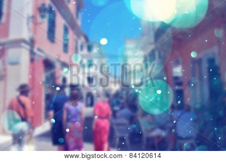 people on a vacation in corfu town with bokeh effect