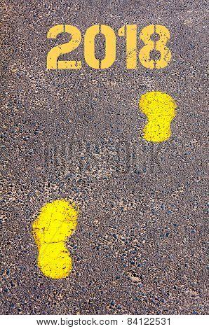 Yellow Footsteps On Sidewalk Towards 2018 Message