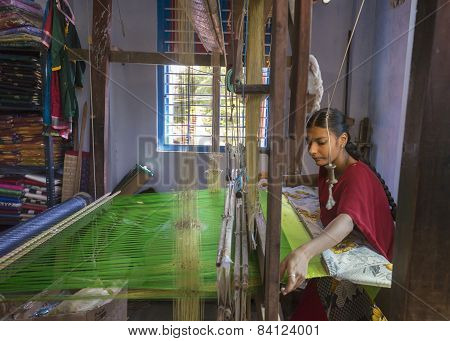 Female Weaving Silk Saris On A Hand Loom.