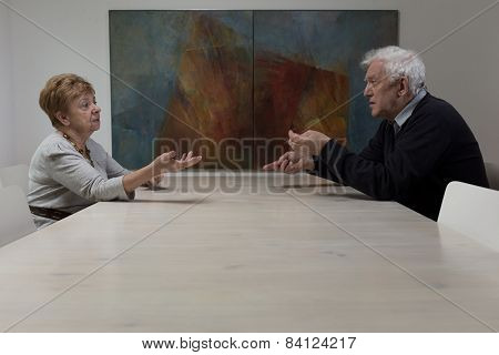 Sitting At The Table And Arguing