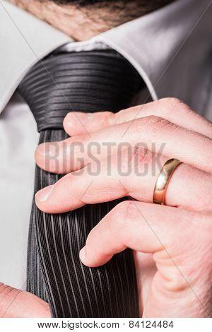 Man Adjust Tie