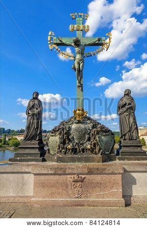 Crucifixion, statue with Hebrew lettering in Charles Bridge Prague, Czech Republic