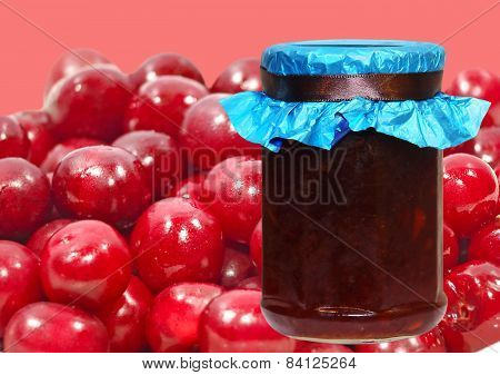 Cherry Jam Jar On A Ripe Berries Background.