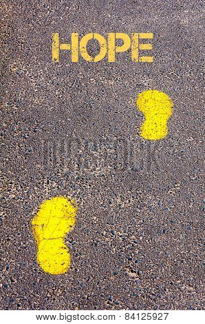Yellow Footsteps On Sidewalk Towards Hope Message