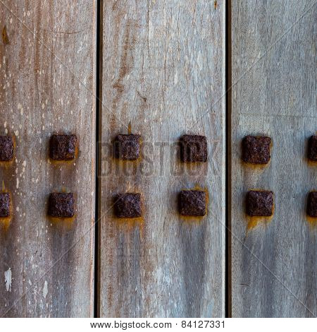 Wood Door With Metallic Spikes