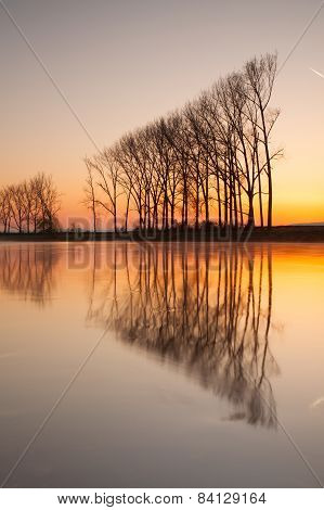 Symmetry On The River At Sunrise