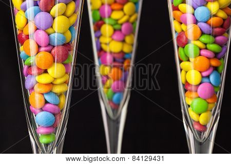 Color Chocolate tablets Inside The Champagne Glasses