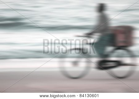 Cyclist At The Beach