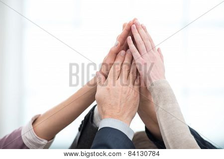 Close up of business team holding hands to hands