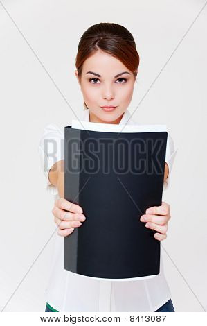 Businesswoman Showing Her Report In Black Folder