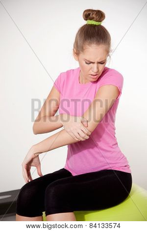 Woman With Injured Arm During Workout