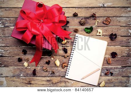 Blank Notebook With Red Gift Box On Wooden Table