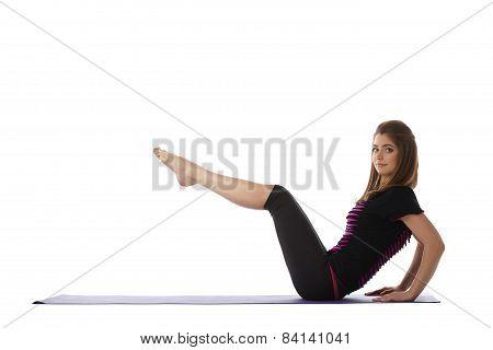 Attractive blue-eyed woman exercising aerobics