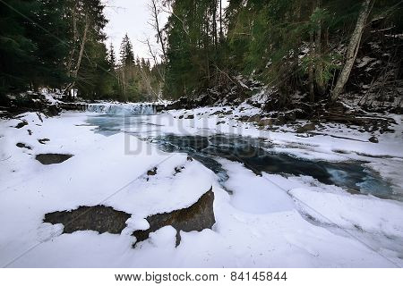 Mountain River In Ice In A Snowy Forest