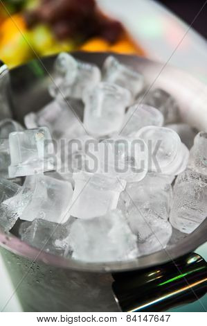 Ice cubes in metallic bucket for shampaghe