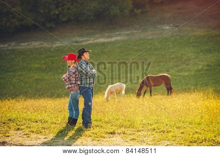 Young married couple in the summer on the farm.