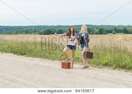 Student Girls Wearing Sunglasses Hitchhike On Road
