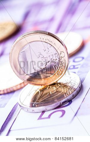 Several 500 euro banknotes and coins are adjacent. Symbolic photo for wealth.