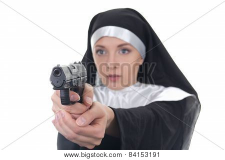 Portrait Of Young Woman Nun Shooting With Gun Isolated On White