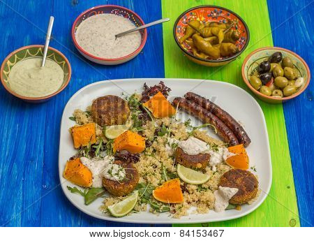 Quinoa With Roasted Pumpkin, Falafel And Sausages