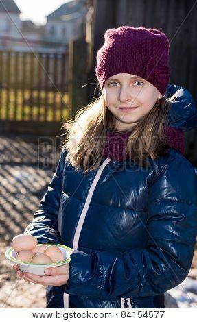 Pretty Girl Holding  Organic Eggs