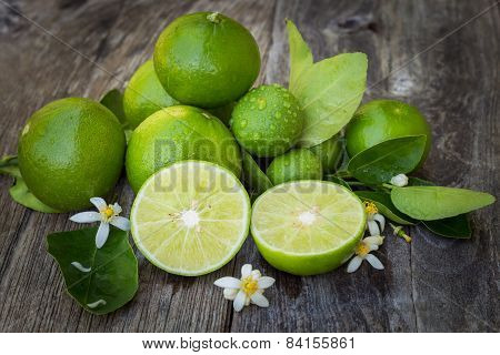 Group Green Lime Lemon On Wood Background