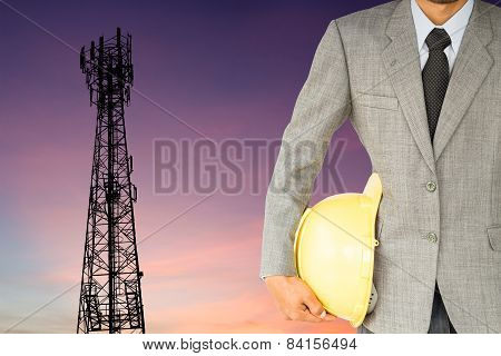 Businessman Engineer And Telecommunication Tower At Sunset Background