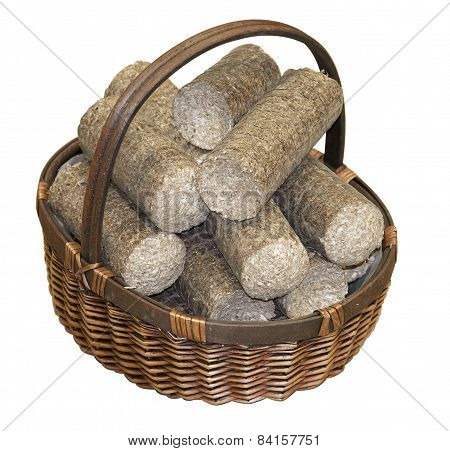 Wood Pellets Arranged In A Wicker Basket, Isolated On White Background