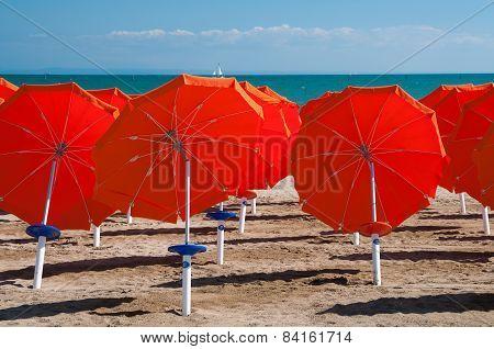Umbrellas On Sandy Beach