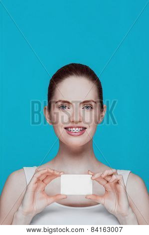 Beautiful Girl With Braces And White Card In Hands
