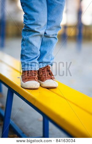 Children's stylish jeans and shoes on the latest fashion trends