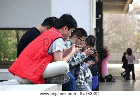 Young People Are Busy With Their Smartphones