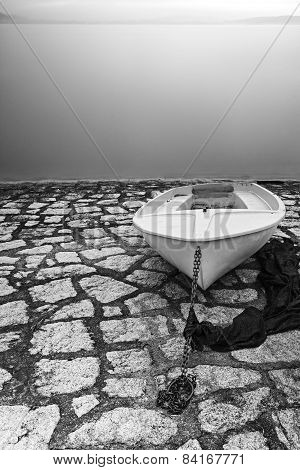 Boat on the lakeshore, Lake Maggiore. Black and white photo