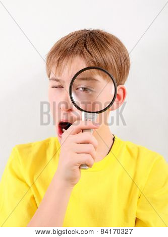 Kid With Magnifying Lens