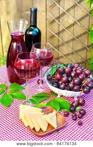 Two Glasses Of Delicious Homemade Semisweet  Red Wine With Grapes