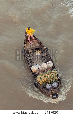 Woman on boat at Can Tho Floating Market