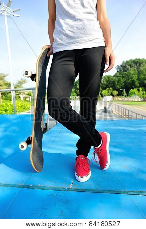 skateboarding woman legs at skatepark