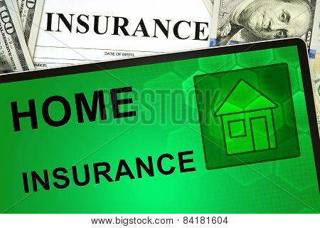 Tablet with Home insurance  online and money.