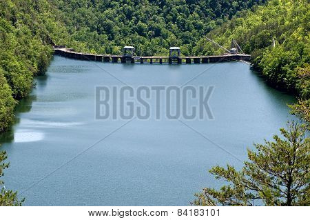 Hydro Electric Dam On Mountain Lake