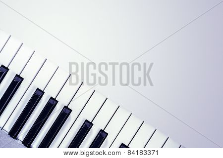 View From Above Of A Synthesizer Keyboard  Isolated On A Gradient Gray