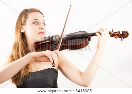 A young beautiful woman playing a violin or fiddle