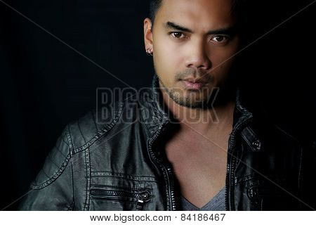 handsome Asian man dressed in black