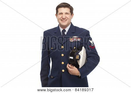 Smiling Coast Guard Serviceman Against White Background