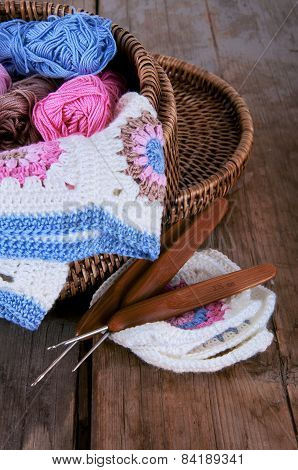 Box Of YarnAnd Granny Square Blanket With Crochet Hooks