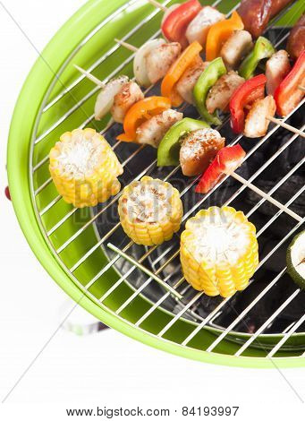 barbecue skewers and grilled vegetables isolated on white