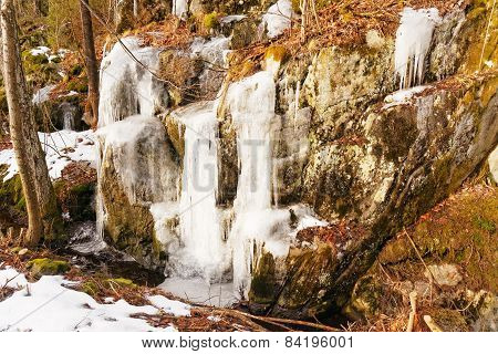 Ice Overhangs On Rocks